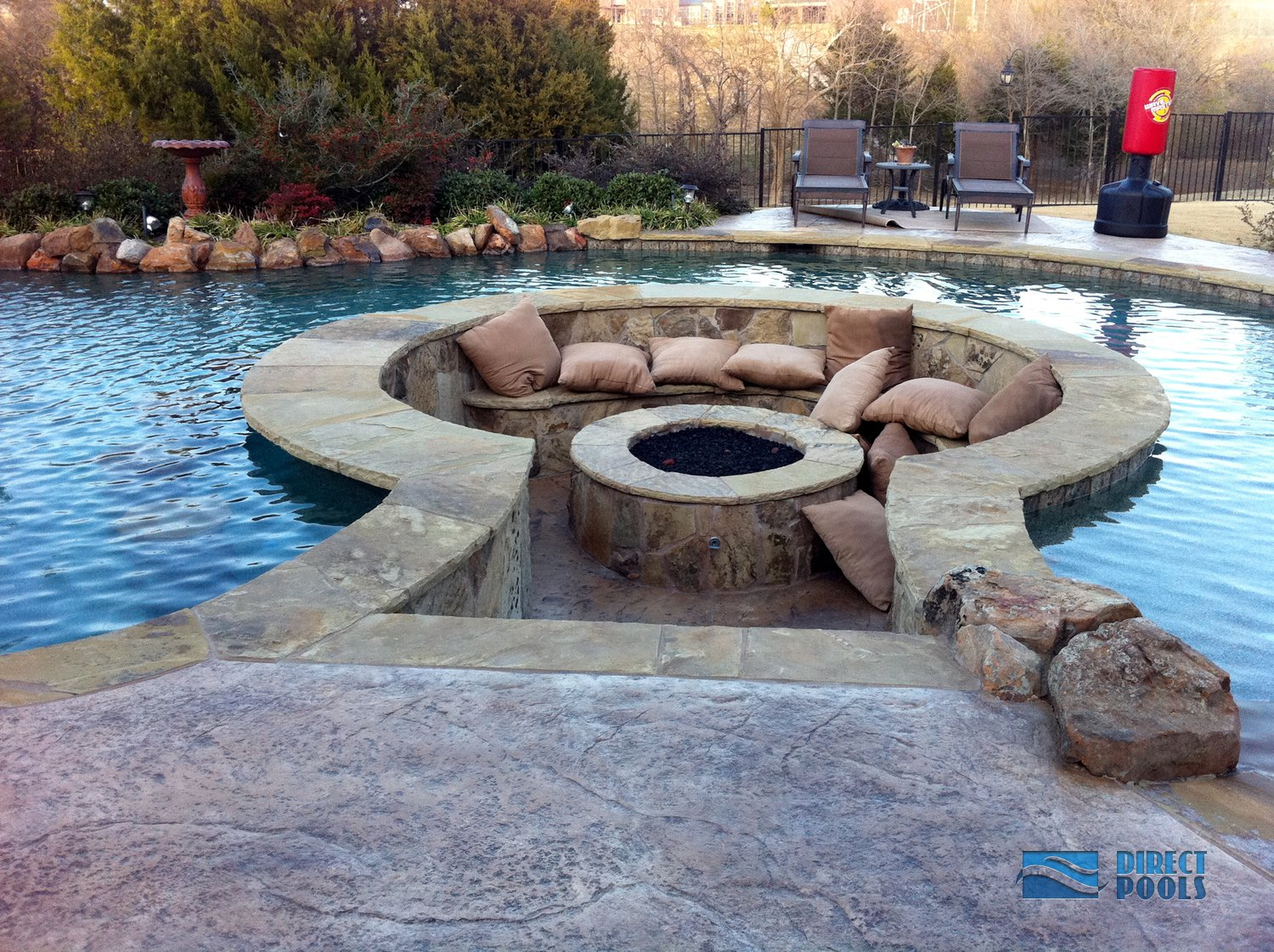 11 amazing designs of fire pits built inside pools for Custom inground pools