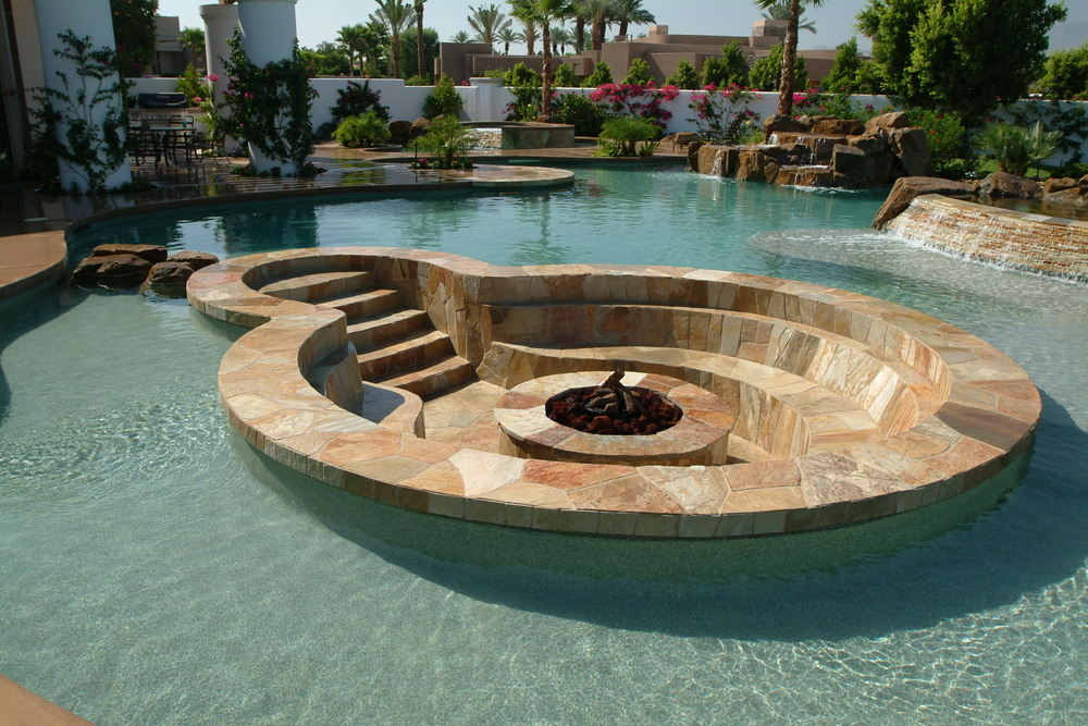 11 amazing designs of fire pits built inside pools for Pool and firepit design
