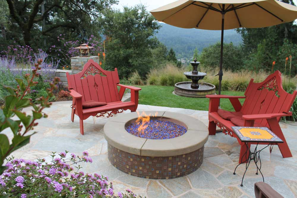 Outdoor fire pit with fire pit glass by Tom Ralston